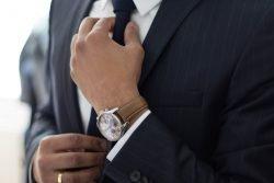business man straghtening his tie